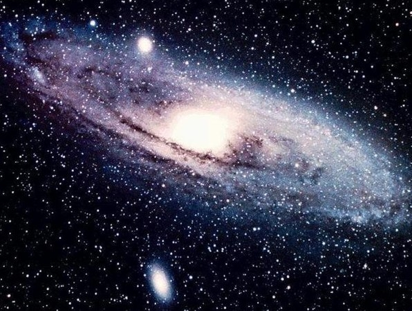 The Andromeda Galaxy (M 31) is the closest large spiral to us (at only 2 million light years) and is visible to the naked eye in the constellation Andromeda. It is 1.5-2 times more massive than the Milky Way.